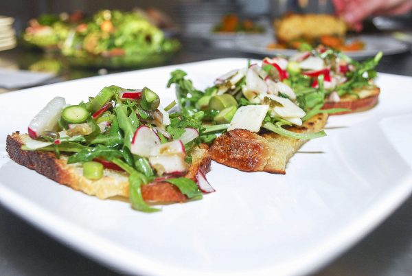 At the Wallace House, chef Katie Porter prepares delicious fruit- and veggie-forward dishes, like this loaded crostini. (Courtesy of The Wallace Centers of Iowa)