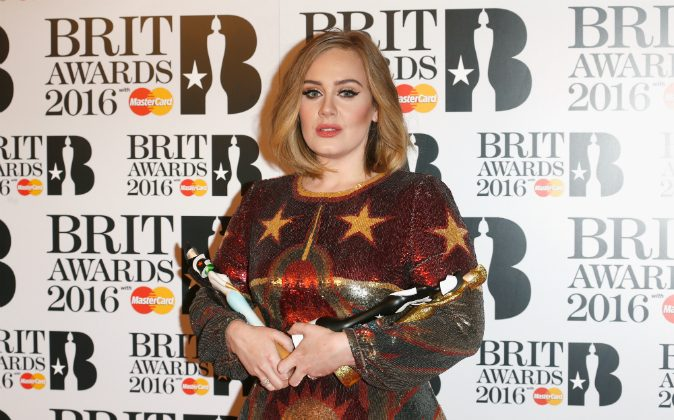 Adele poses in the winners room at the BRIT Awards 2016 with her 4 Brit awards at The O2 Arena on February 24, 2016 in London, England. (Luca Teuchmann/Getty Images)