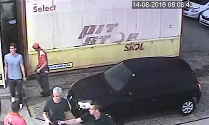 In thisSunday, Aug. 14, 2016 frame from surveillance video released byBrazil Police, swimmerRyan Lochte, second from right, of the United States, and teammates, appear at a gasstation during the 2016 Summer Olympics inRio de Janeiro, Brazil. A top Brazil police official said the swimmers damaged property at the gas station. (Brazil Police via AP)