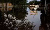 Search for Living, Dead: Louisiana Fights Back From Flooding