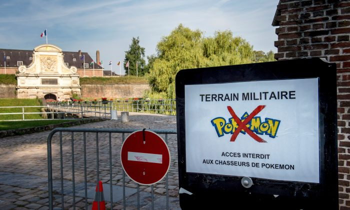 """A board forbidding to play the 'Pokemon Go' app inside the """"Citadelle"""" military area in Lille, northern France, on August 16, 2016. The global Pokemon Go craze has prompted a slew of complaints, from memorial sites arguing it's disrespectful to play there, to whole countries imposing a ban on the smart phone game. (PHILIPPE HUGUEN/AFP/Getty Images)"""