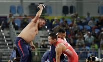Mongolian Wrestling Coaches Strip Down in Public Protest at Rio Olympics