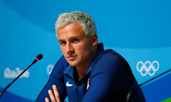 Ryan Lochte of the United States attends a press conference in the Main Press Center on Day 7 of the Rio Olympics in Rio de Janeiro, Brazil on Aug. 12, 2016. (Matt Hazlett/Getty Images)