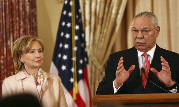 Former U.S. Secretary of State Colin Powell (R) speaks with U.S. Secretary of State Hillary Clinton during an unveiling ceremony for his official State Department portrait in the Benjamin Franklin Room at the State Department Dec. 7, 2009 in Washington, DC. (Win McNamee/Getty Images)