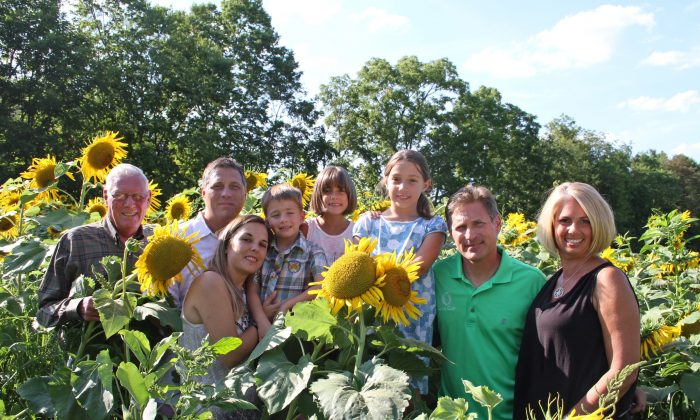 (L–R) John Haight, Jeff Haight and his wife Allison Haight; children Colin, Delaney, and Claudia; Kevin Haight, and his wife Traci Simonton at the sunflower field in La Grange, New York in August. (Michelle Sottile)