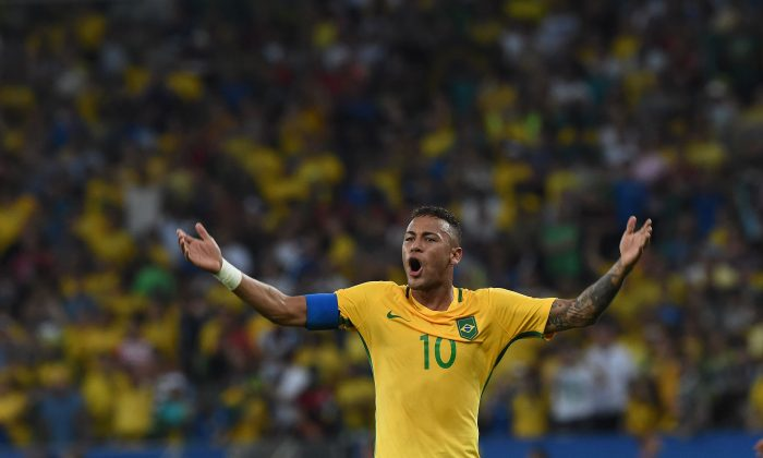 Brazil's forward Neymar celebrates scoring his team's first goal during the Rio 2016 Olympic Games men's football gold medal match between Brazil and Germany at the Maracana stadium in Rio de Janeiro on August 20. (Vanderlei Almeida/AFP/Getty Images)