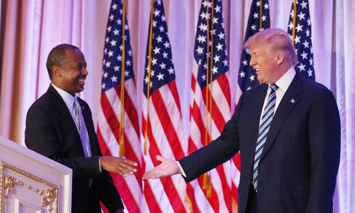 Republican presidential candidate Donald Trump with former presidential candidate Ben Carson as he receives his endorsement at the Mar-A-Lago Club on March 11, 2016 in Palm Beach, Florida. (Joe Raedle/Getty Images)