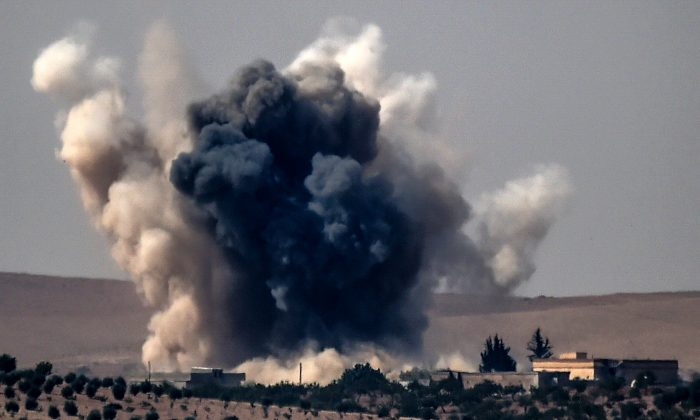 Stock photo of smoke billows following air strikes. (Bulent Kilic/AFP/Getty Images)