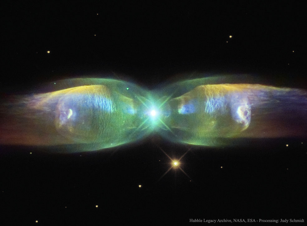 The M2-9 butterfly planetary nebula 2,100 light-years away shows the beauty of dying stars. In the center, two stars orbit inside a gaseous disk 10 times the orbit of Pluto. The expelled envelope of the dying star breaks out from the disk creating the bipolar appearance. Much remains unknown about the physical processes that cause planetary nebulae. (Hubble Legacy Archive, NASA, ESA, Processing: Judy Schmidt)