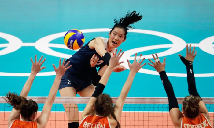 Chinese volleyball player Zhu Ting strikes the ball at the Netherlands defence during the Women's Volleyball Semifinal match at the Maracanazinho at Rio Olympic Games in Rio de Janeiro, Brazil, on August 18, 2016. (Jamie Squire/Getty Images)