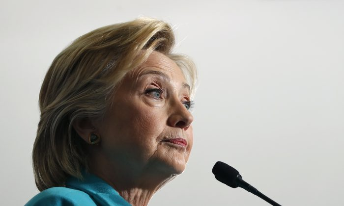 Democratic presidential candidate Hillary Clinton pauses as she speaks at a campaign event at Truckee Meadows Community College, in Reno, Nev., on Aug. 25, 2016. (AP Photo/Carolyn Kaster)