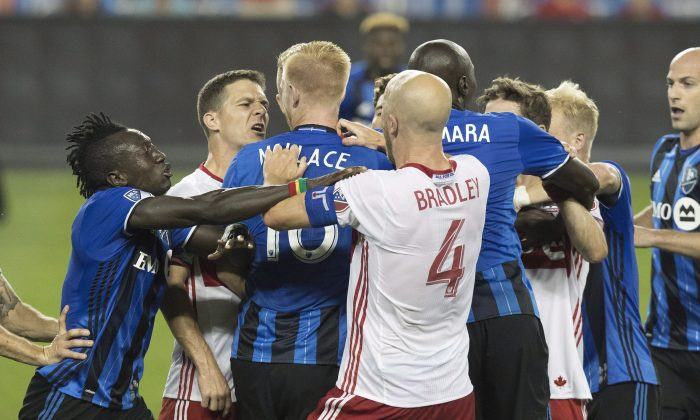 Toronto FC and Montreal Impact players push and shove in the first half at BMO Field in Toronto on Aug. 27, 2016. Montreal's Callum Mallace was sent off for his actions that led to the skirmish. (The Canadian Press/Fred Thornhill)