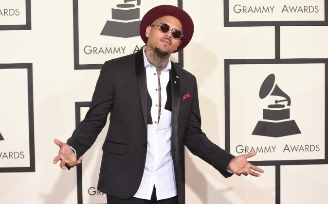 Singer Chris Brown attends The 57th Annual GRAMMY Awards at the STAPLES Center on February 8, 2015 in Los Angeles, California. (Jason Merritt/Getty Images). A woman claimed Chris Brown threatened her with a gun on Aug. 30.