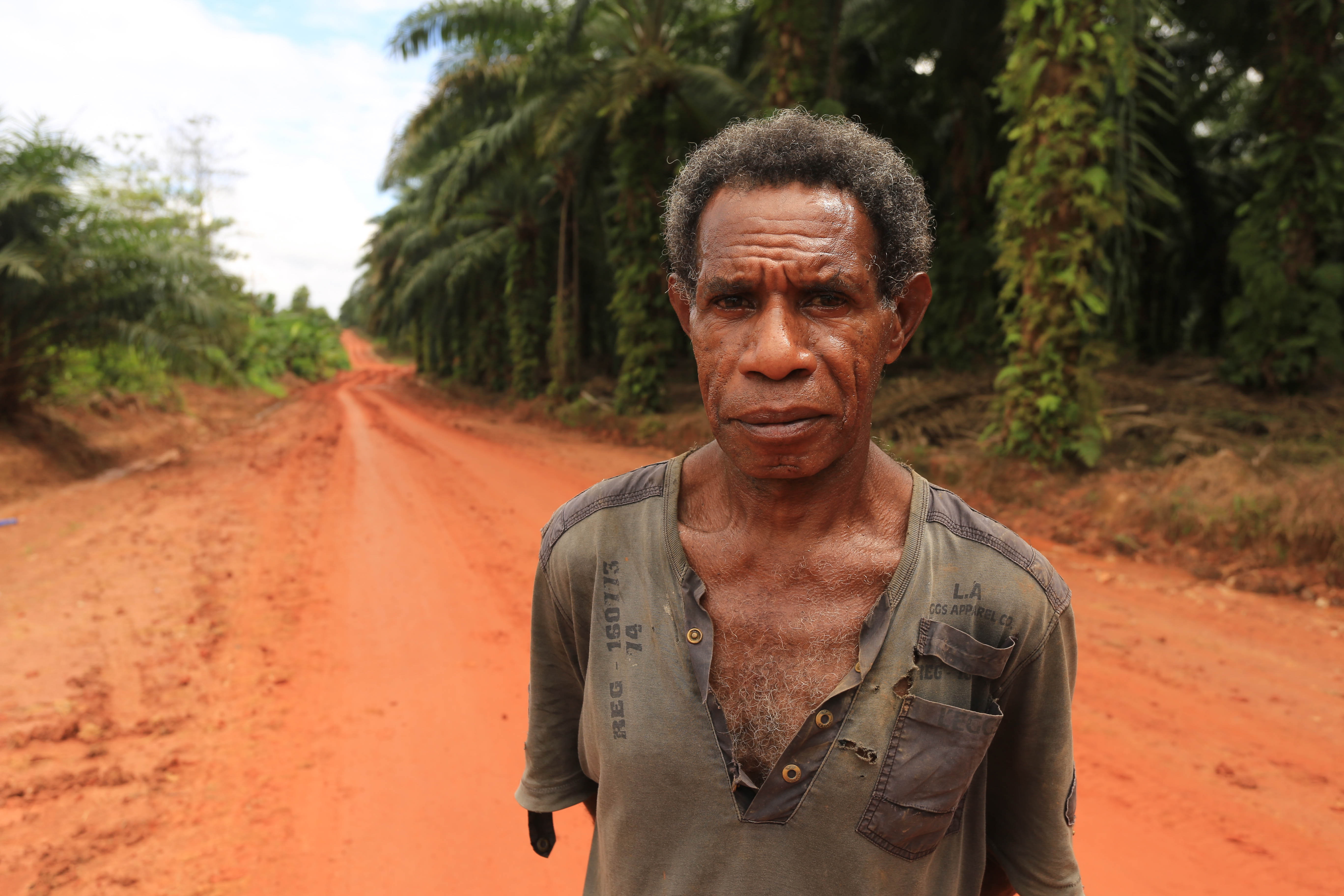 A file photo of an indigenous man, who is part of a community occupying the forest land on the edge of Korindo's PT Tunas Sawa Erma plantation in Papua, Indonesia. (Mighty)