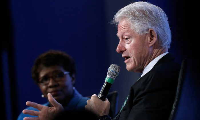"Former U.S. President Bill Clinton at the Peter G. Peterson Foundation's fifth annual fiscal summit on ""Our Economic Future"" on May 14, 2014 in Washington, DC. (Win McNamee/Getty Images)"
