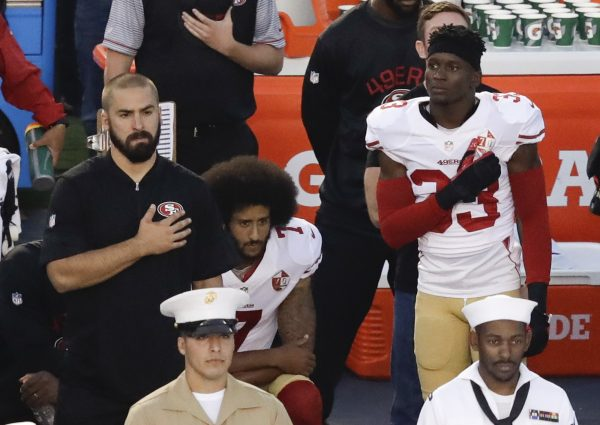 San Francisco 49ers quarterback Colin Kaepernick (C) kneels during the national anthem before the team's NFL preseason football game against the San Diego Chargers, in San Diego, on Sept. 1, 2016. (AP Photo/Chris Carlson)