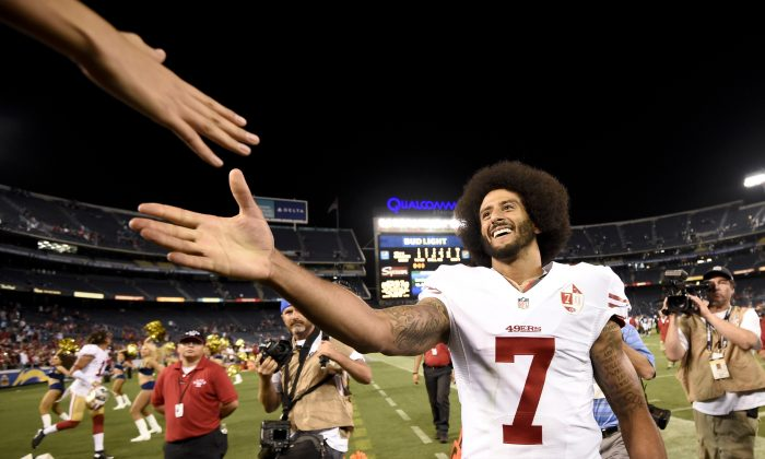 San Francisco 49ers quarterback Colin Kaepernick shakes hands with fans after the 49ers defeated the San Diego Chargers 31-21 during an NFL preseason football game in San Diego on Sept. 1, 2016. Kaepernick's jersey is the league's top seller. (AP Photo/Denis Poroy)