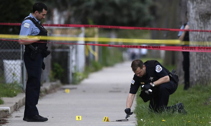 At least 74 people were shot and 11 died in a weekend of violence in Chicago. (Joshua Lott/Getty Images)