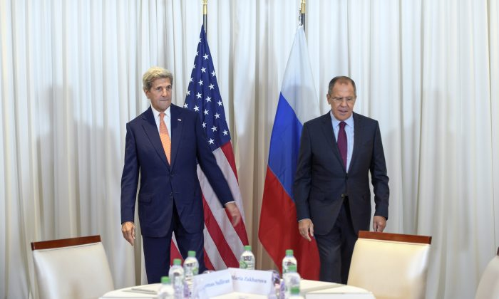 U.S. Secretary of State John Kerry (L) and Russian Foreign Minister Sergei Lavrov met in Geneva on Aug. 26, 2016, for an expected push towards resuming peace talks for war-ravaged Syria. (Martial Trezzini/AFP/Getty Images)