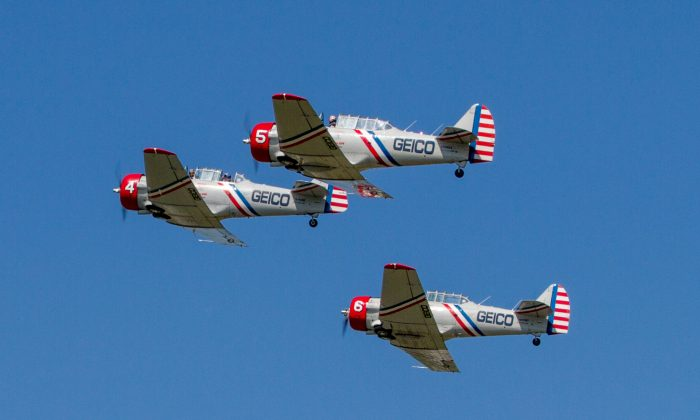 Three GEICO Skytypers at the New York Air Show on Sept. 4, 2016 at Stewart International Airport in New Windsor. (Colin Fredericson/Epoch Times)
