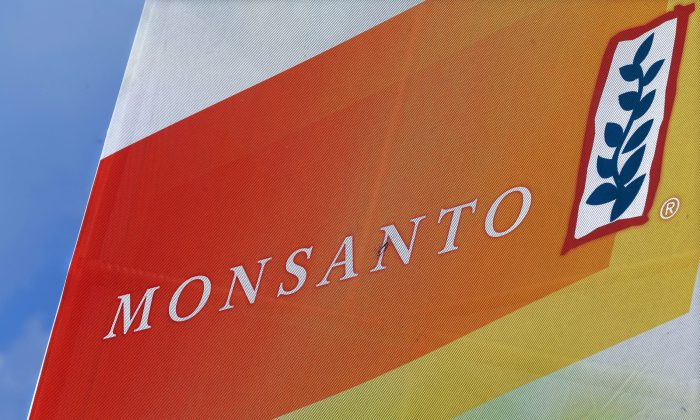 The Monsanto logo on display at the Farm Progress Show in Decatur, Ill. (AP Photo/Seth Perlman, File)
