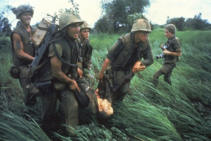 Marines recovering a comrade while under fire in Vietnam in 1966. (Larry Burrows CC BY 2.0 https://goo.gl/sZ7V7x via Flickr)