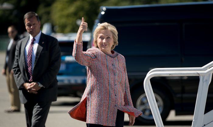 Democratic presidential candidate Hillary Clinton  as she arrives to board her campaign plane at Westchester County Airport in White Plains, N.Y., Thursday, Sept. 15, 2016. (AP Photo/Andrew Harnik)