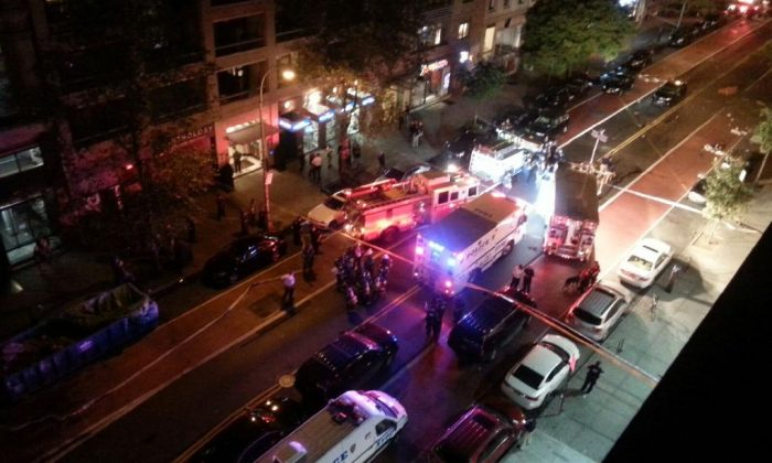 The NYPD and emergency responders on 23rd Street between 6th and 7th Avenues where a bomb exploded injuring at least 29 in New York on Sept. 17, 2016. (Epoch Times)