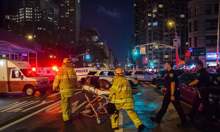Police and firefighters work near the scene of an apparent explosion in Manhattan's Chelsea neighborhood, in New York, on Sept. 17, 2016. (AP Photo/Andres Kudacki)