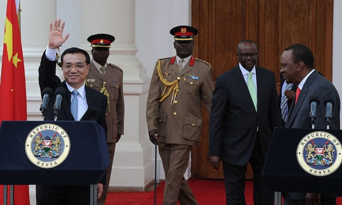 China's Premier, Li Keqiang (L) waves after giving a press conference with Kenyan President, Uhuru Kenyatta at State House in the capital Nairobi on May 10, 2014. (Tony Karumba/AFP/Getty Images)
