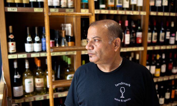 Binod Bhattarai, 51, assitant manager at Landmark Wine and Spirits on 23rd St. in Chelsea, Manhattan, New York, on Sept. 20, 2016. (Petr Svab/Epoch Times)