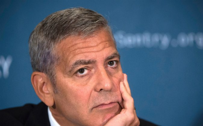 Actor George Clooney, human rights activist and co-founder of Sentry, speaks during a news conference on September 12, 2016, in Washington, DC, to present the report War Crimes Shouldnt Pay: Stopping the looting and destruction in South Sudan. Clooney is sad to hear about Angelina Jolie and Brad Pitt's impending divorce. (MOLLY RILEY/AFP/Getty Images)