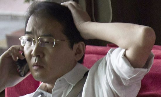 Chinese Activist Lawyer Sentenced to 12 Years on Fraud Charges