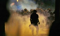 Report: Charlotte Rioters Try to Throw Photographer into Fire
