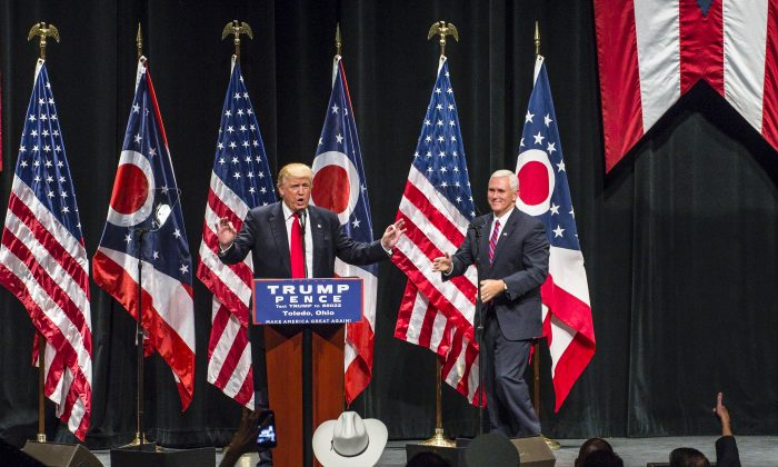 Republican presidential nominee Donald Trump welcomes his running mate, Gov. Mike Pence, to the stage as he addresses supporters at the Stranahan Theater on September 21, 2016 in Toledo, Ohio. (Angelo Merendino/Getty Images)