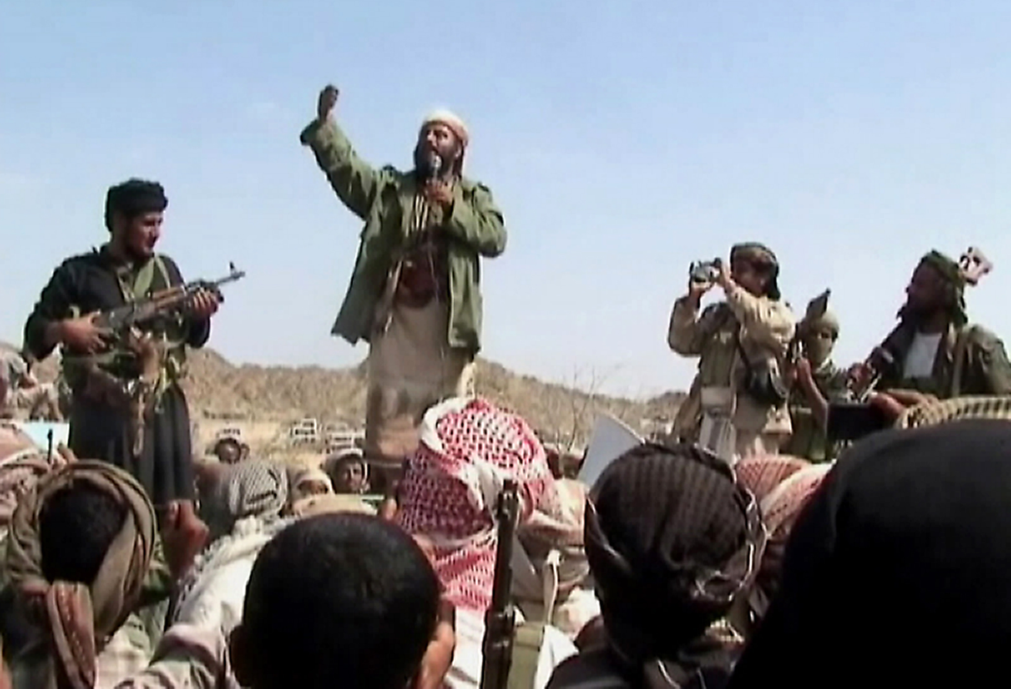A man claiming to be an al-Qaida member addresses a crowd gathered in southern Yemen's Abyan Province on Dec. 22, 2009. (AFP/Getty Images)