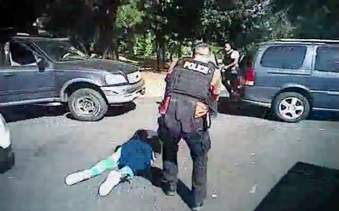 This image made from video provided by the Charlotte-Mecklenburg Police Department on Sept. 24, 2016 shows Keith Scott on the ground as police approach him in Charlotte, N.C., on Sept. 20, 2016. (Charlotte-Mecklenburg Police Department via AP)