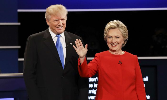 Republican presidential candidate Donald Trump and Democratic presidential nominee Hillary Clinton are introduced during the presidential debate at Hofstra University in Hempstead, N.Y., on Sept. 26, 2016. (AP Photo/David Goldman)