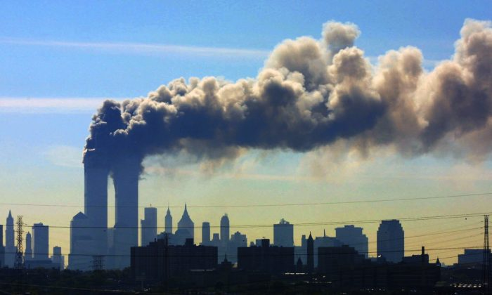 Smoke billows from the twin towers of the World Trade Center in New York  on Sept. 11, 2001.  (AP Photo/Gene Boyars)
