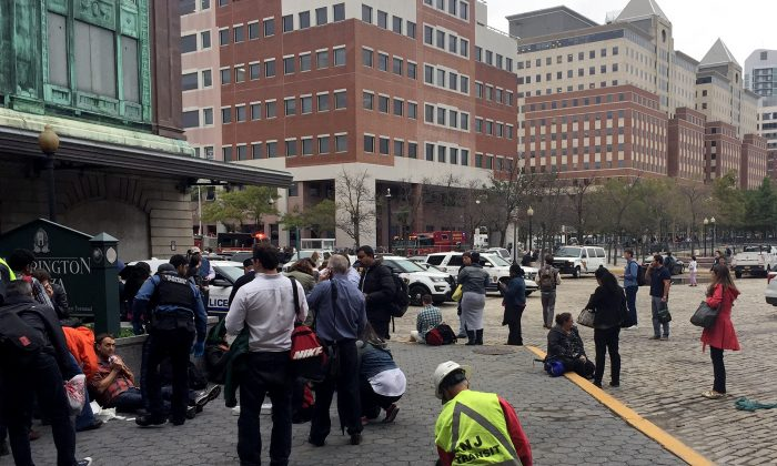 People are treated for their injuries outside after a NJ Transit train crashed in to the platform at Hoboken Terminal in on Sept. 29 New Jersey. (Pancho Bernasconi/Getty Images)