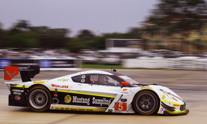 Christian Fittipaldi, Filipe Albuquerque, and Joao Barbosa in the  #5 Action Express Coyote-Corvette won the IMSA championship in 2014 and 2015. (Chris Jasurek/Epoch Times)