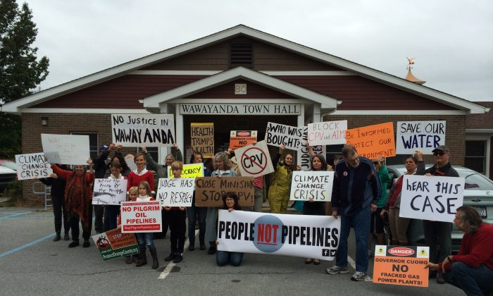 People protesting the Competative Power Ventures Plant outside the Wawayanda Court House in Wawayanda on Sept. 29, 2016. Six protesters were supposed to stand trial that day but their trial was postponed the day before by the judge who cited the absence of one of the defendants and the need to review their defense as the reasons for the postponement, according to the group's attorney.(Holly Kellum/Epoch Times)