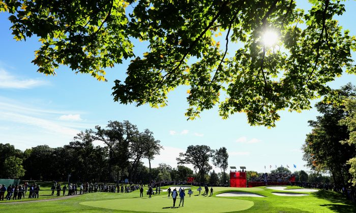 Players walk to the fourth green while practicing prior to the 2016 Ryder Cup at Hazeltine National Golf Club on September 27, 2016 in Chaska, Minnesota. (Andrew Redington/Getty Images)