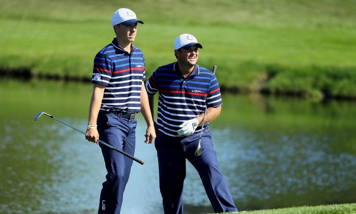 Jordan Spieth looks on with Patrick Reed during practice prior to the 2016 Ryder Cup at Hazeltine National Golf Club on September 29, 2016 in Chaska, Minnesota. (Andrew Redington/Getty Images)