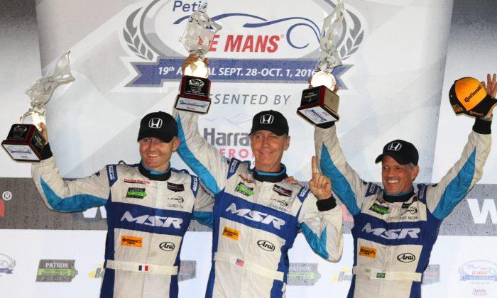 Oswaldo Negri, John Pew, and Oswaldo Negri celebrate winning the 2016 IMSA WeatherTech SportsCar Championship season finale, the ten-hour Petit Le Mans, Oct. 1, 2016. (Chris Jasurek/Epoch Times)