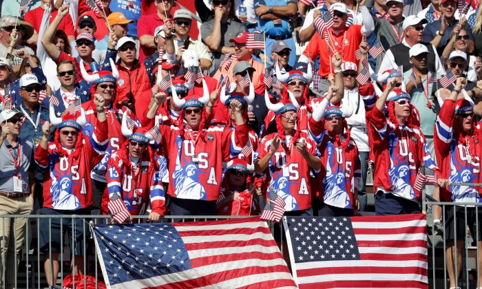 United States fans cheer at the first tee during afternoon fourball matches of the 2016 Ryder Cup at Hazeltine National Golf Club on September 30 in Chaska, Minnesota. (Streeter Lecka/Getty Images)