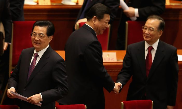 (L-R) Former Chinese Communist Party leader Hu Jintao, incumbent Party Xi Jinping, and former Chinese premier Wen Jiabao in the Great Hall of the People in Beijing on March 3, 2013.  (Feng Li/Getty Images)