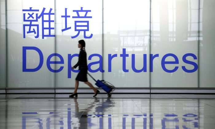 A woman heads towards a departure gate at Chek Lap Kok airport in Hong Kong in this file photo. (Christian Keenan/Getty Images)