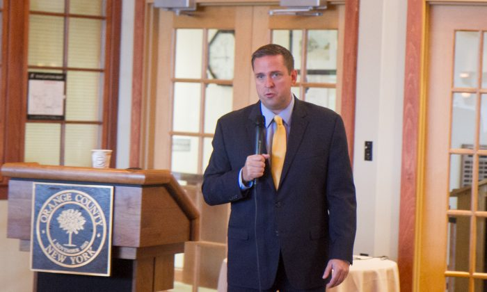 Orange County Executive Steven Neuhaus delivers his state of the county address at Graham Skea Lodge, Thomas Bull Memorial Park in Montgomery on Sept. 30, 2016. The county's financial outlook is better than last year, both according to the county's credit rating, and a number of economic indicators like lower unemployment, tax base growth, and fewer delinquent properties. (Holly Kellum/Epoch Times)