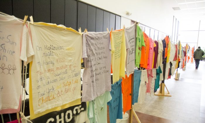 The Clothesline Project at the offices of Safe Homes of Orange County in Newburgh on Oct. 3, 2016. The Clothesline Project gives the stories of domestic violence victims and will be traveling to Middletown and Port Jervis during the month of October, Domestic Violence Awareness Month. (Holly Kellum/Epoch Times)